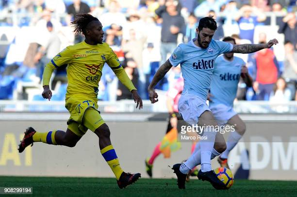 Luis Alberto of SS Lazio competes for the ball with Samuel Bastien of AC Chievo Verona during the Serie A match between SS Lazio and AC Chievo Verona...
