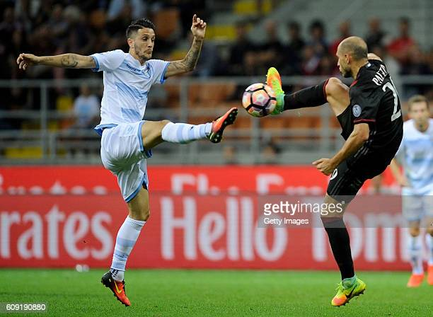 Luis Alberto of SS Lazio is tackled by Gabriel Paletta of AC Milan during the Serie A match between AC Milan and SS Lazio at Stadio Giuseppe Meazza...