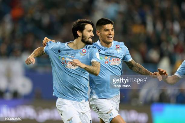 Luis Alberto Romero Alconchel of SS Lazio and his teammate Carlos Joaquin Correa celebrate the opening goal of the Italian Supercup match between...
