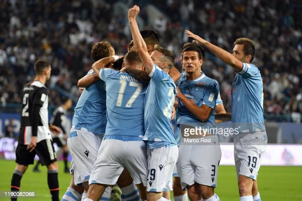 Luis Alberto Romero Alconchel of SS Lazio celebrates after scoring the opening goal with teammates during the Italian Supercup match between Juventus...