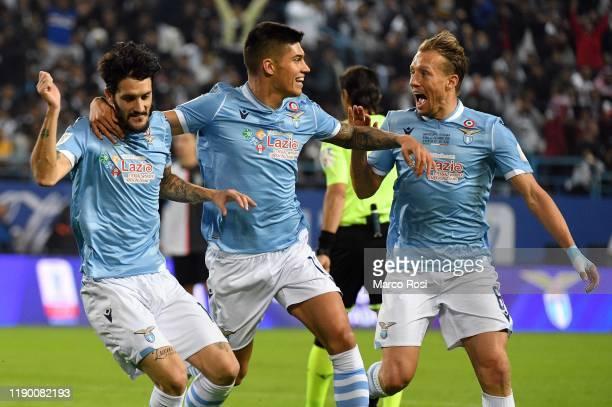 Luis Alberto Romero Alconchel of SS Lazio celebrates after scoring the opening goal with teammates Carlos Joaquin Correa and Lucas Leiva Pezzini...