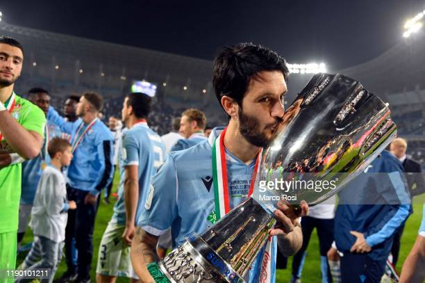 Luis Alberto Romero Alconchel of SS Lazio celebrates with the trophy the winning of the Italian Supercup after the Italian Supercup match between...