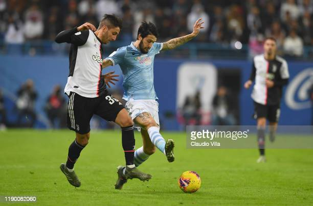 Luis Alberto Romero Alconchel of SS Lazio competes for the ball against Rodrigo Bentancur of Juventus during the Italian Supercup match between...