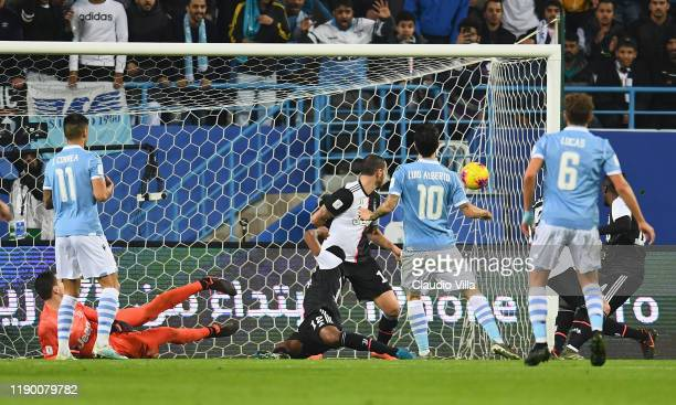 Luis Alberto Romero Alconchel of SS Lazio scores the opening goal of the Italian Supercup match between Juventus and SS Lazio at King Saud University...