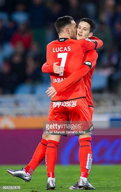 Luis Alberto Romero of Deportivo La Coruna celebrates with his teammate Lucas Perez of Deportivo La Coruna after scoring the opening goal during the...