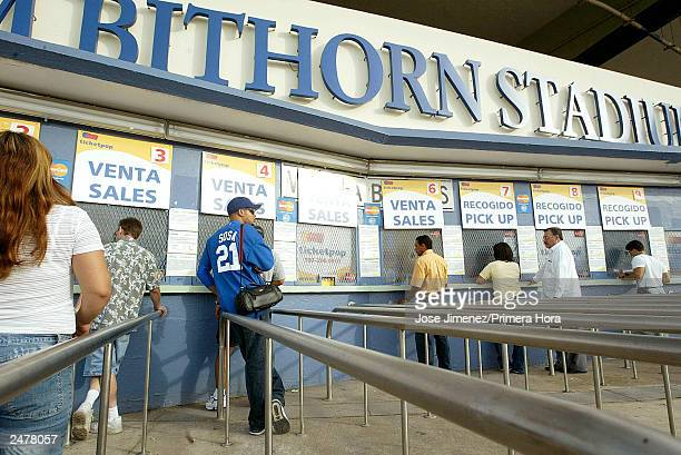 Luis Alberto Sanchez waits out side the ticket box office to buy tickets to see the Chicago Cubs play the Montreal Expos September 9, 2003 at Hiram...