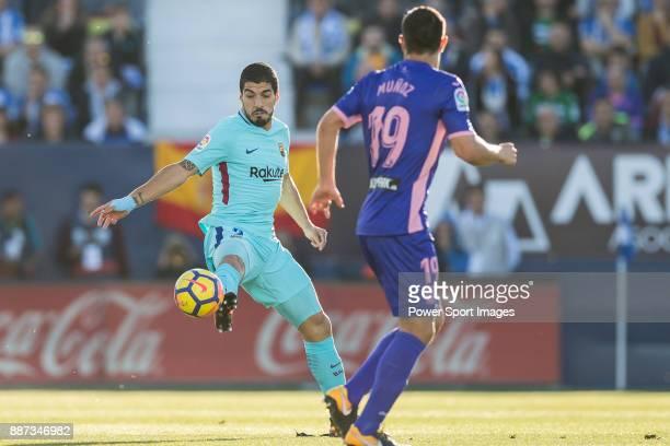 Luis Alberto Suarez Diaz of FC Barcelona fights for the ball with Ruben Salvador Perez del Marmol of CD Leganes and Ezequiel Matias Munoz of CD...