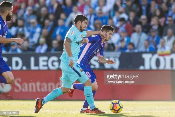 Luis Alberto Suarez Diaz of FC Barcelona fights for the ball with Joseba Zaldua Bengoechea of CD Leganes during the La Liga 201718 match between CD...
