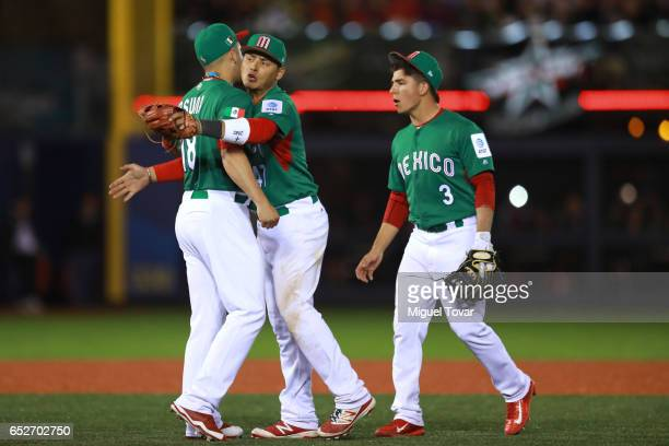 Luis Alfonso Cruz center of Mexico celebrates after winning with teammate Roberto Osuna in the bottom of the ninth inning during the World Baseball...
