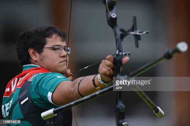 Luis Alvarez of Mexico competes in his men's individual archery 1/16 eliminations match against Oh Jin Hyek of South Korea during the men's...