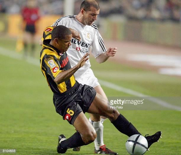 "Luis Alvaro of Zaragoza and Zinedine Zidanne of Real Madrid clash during the ""Copa del Rey"" final between Real Madrid and Zaragoza at Montjuic..."