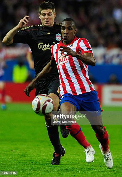 Luis Amaranto Perea of Atletico Madrid is chased by Steven Gerrard of Liverpool during the UEFA Europa League Semi Final first leg match between...