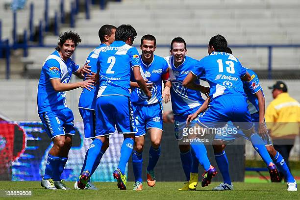 Luis Angel Landin of Puebla celebrates a scored goal during against Pumas during a match between Pumas v Puebla as part of the Clausura 2012 at...