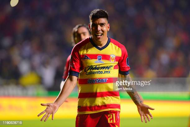 Luis Angel Mendoza of Morelia celebrates after scoring the third goal of his team during the quarterfinals first leg match between Morelia and Leon...
