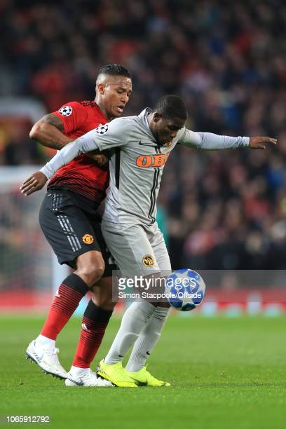 Luis Antonio Valencia of Man Utd and Roger Assale of Young Boys battle for the ball during the Group H match of the UEFA Champions League between...