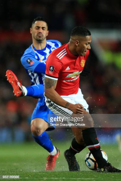 Luis Antonio Valencia of Man Utd battles with Beram Kayal of Brighton during The Emirates FA Cup Quarter Final match between Manchester United and...