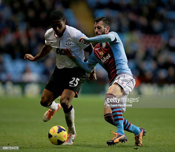 Luis Antonio Valencia of Manchester United battles with Antonio Luna of Aston Villa during the Barclays Premier League match between Aston Villa and...