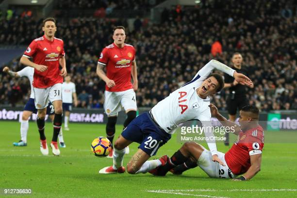 Luis Antonio Valencia of Manchester United brings down Dele Alli of Tottenham Hotspur in the penalty area during the Premier League match between...