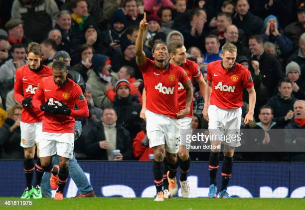 Luis Antonio Valencia of Manchester United celebrates scoring the opening goal during the Barclays Premier League match between Manchester United and...