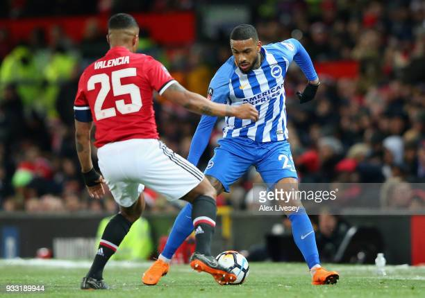 Luis Antonio Valencia of Manchester United is challenged by Jurgen Locadia of Brighton during the Emirates FA Cup Quarter Final between Manchester...