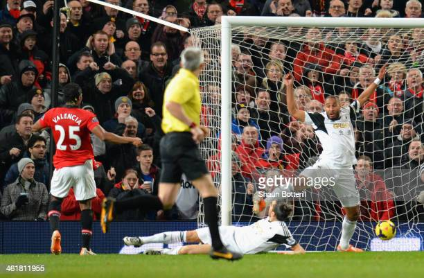Luis Antonio Valencia of Manchester United scores the opening goal during the Barclays Premier League match between Manchester United and Swansea...