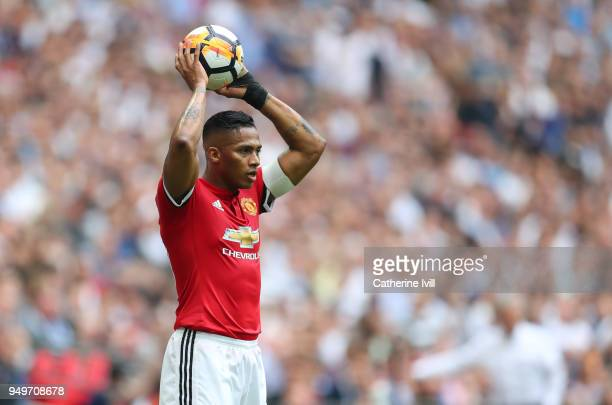Luis Antonio Valencia of Manchester United takes a throw in during The Emirates FA Cup Semi Final between Manchester United and Tottenham Hotspur at...