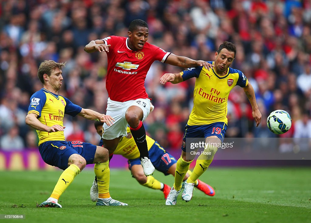 Luis Antonio Valencia of Manchester United takes on Nacho Monreal, Alexis Sanchez and Santi Cazorla of Arsenal during the Barclays Premier League match between Manchester United and Arsenal at Old Trafford on May 17, 2015 in Manchester, England.