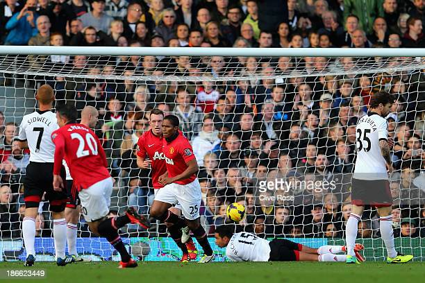 Luis Antonio Valencia of Manchester United turs to celebrate after scoring the first goal during the Barclays Premier League match between Fulham and...