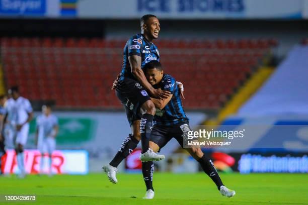 Luis Antonio Valencia of Querétaro celebrates the second scored goal with Jefferson Montero of Querétaro during a match between Queretaro and Pachuca...