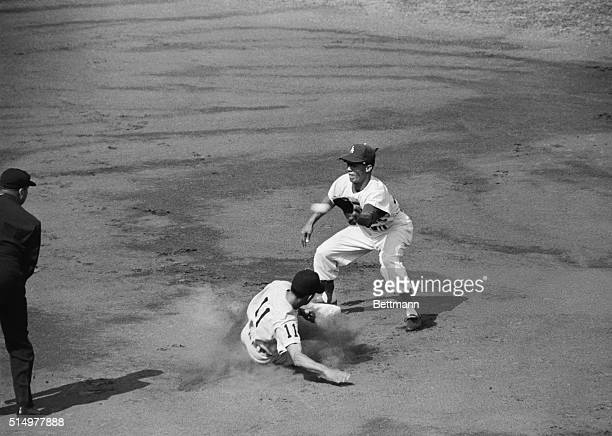 Luis Apariclo Sox ss steals second in the first inning after getting on base with a walk John Roseboro's throw to Maury Wills was late Note ball just...
