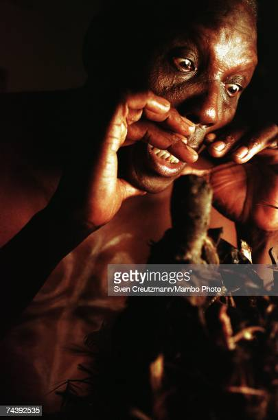 Luis Arere performs an Abacua ceremony in front of a Nganga altar in his home on June 22 2000 in Centro Havana Cuba The fusion and intermingling of...
