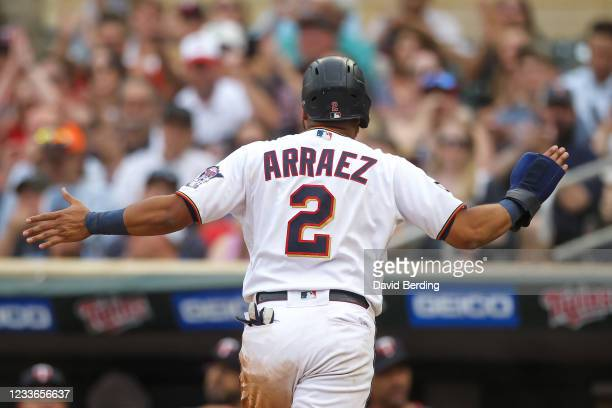 Luis Arraez celebrates after scoring off a sacrifice fly by Josh Donaldson of the Minnesota Twins against the Cleveland Indians in the first inning...