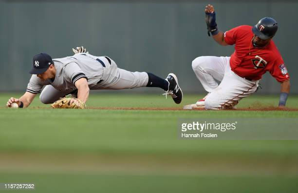 Luis Arraez of the Minnesota Twins is safe as DJ LeMahieu of the New York Yankees is pulled off second base during the third inning of the game on...