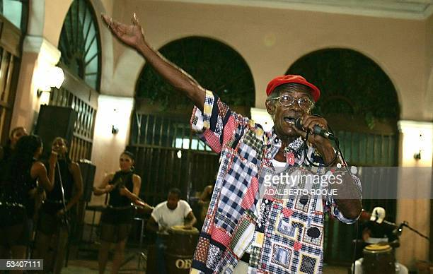 STORY Luis 'Aspirina' Chacon one of the most notorious Cuban folklorists sings accompanied by female folk group 'Obini Bata' 22 July 2005 in Havana...