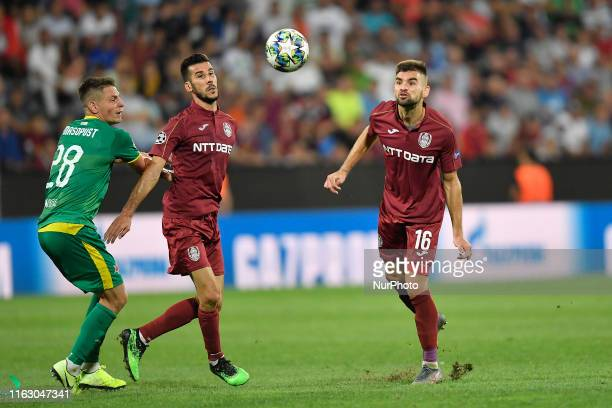 Luis Aurelio and Mateo Susic of CFR Cluj in action against Lukas Masopust of SK Slavia Praha during UEFA Champions League 2019/2020 PlayOffs 1st leg...