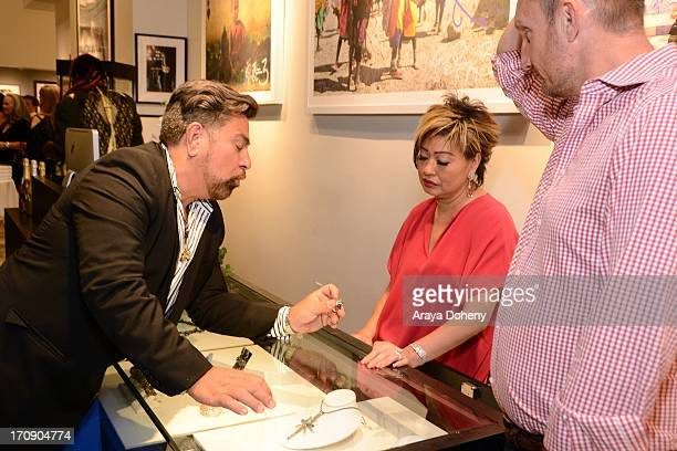 Luis Barajas and Rosalina Lydster attend a gallery exhibit of Terry O'Neill Presents The Opus A 50 Year Retrospective at Mouche Gallery on June 19...