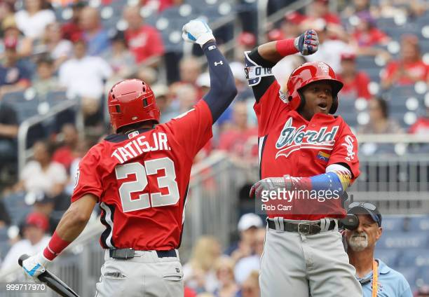 Luis Basabe of the Chicago White Sox and the World Team celebrates his tworun home run in the third inning with teammate Fernando Tatis of the San...