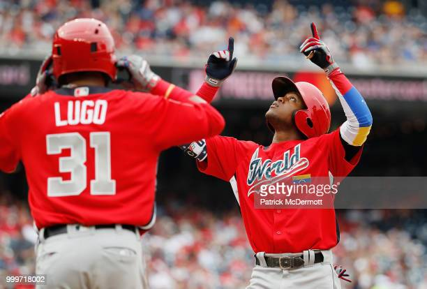 Luis Basabe of the Chicago White Sox and the World Team celebrates his two-run home run in the third inning against the U.S. Team during the SiriusXM...