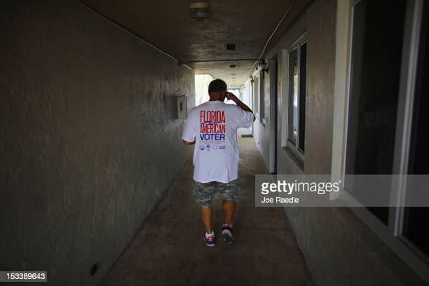 Luis Battiato goes door to door in an apartment complex as he looks for people that have not registered to vote during a voter registration drive by...