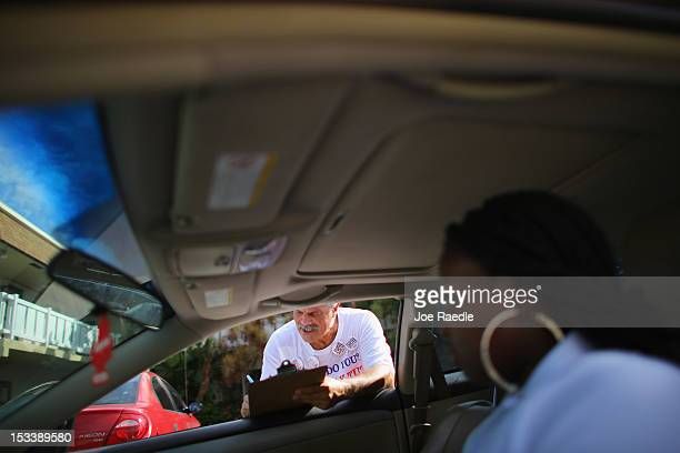Luis Battiato takes down Lechand Lylen's information as he signs her up to vote during a voter registration drive by members of the Florida Immigrant...