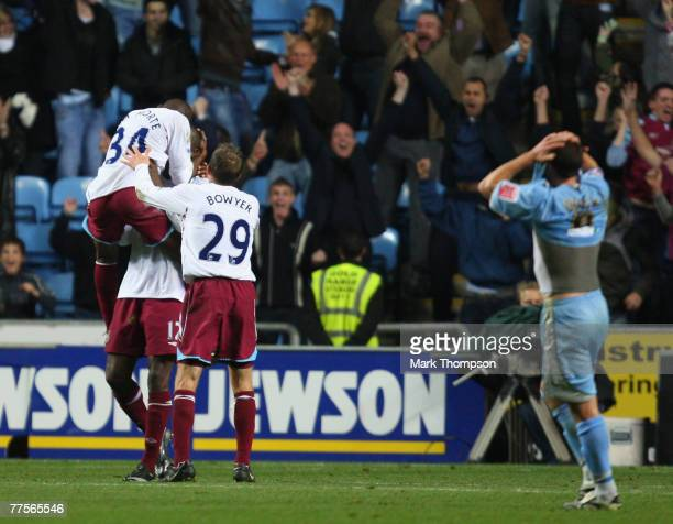 Luis Boa Morte and Lee Bowyer West Ham celebrate teammate Carlton Cole's winning goal with him, while Coventry's Michael Doyle reacts in...