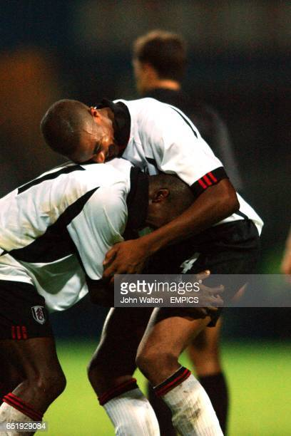 Luis Boa Morte celebrates victory at the final whistle with Steve Marlet