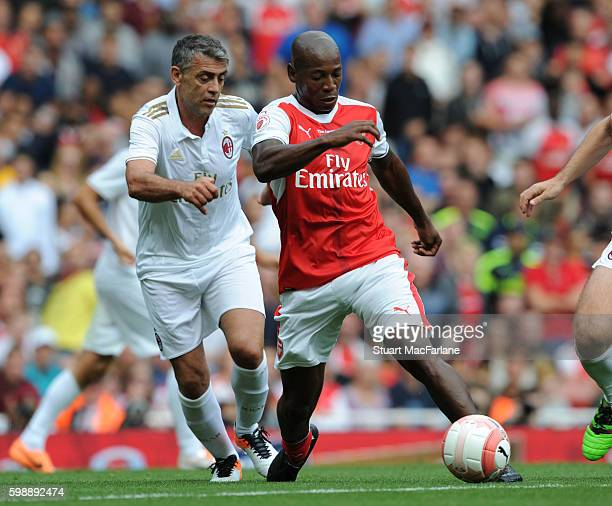 Luis Boa Morte of Arsenal breaks past Angelo Carbone of Milan during the friendly match between the Arsenal Legends and Milan Glorie at Emirates...