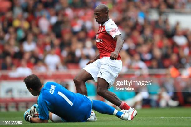 Luis Boa Morte of Arsenal in action with Real Madrid goalkeeper Cesar Sanchez during the match between Arsenal Legends and Real Madrid Legends at...