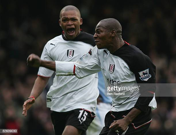 Luis Boa Morte of Fulham celebrates his goal with Collins John during the Barclays Premiership League match between Fulham and Manchester City at...