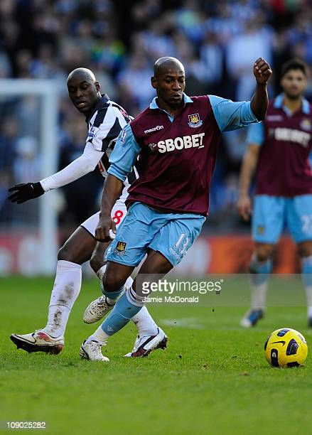 Luis Boa Morte of West Ham United battles with Marc Antoine Fortune of West Bromwich Albion during the Barclays Premiership match between West...