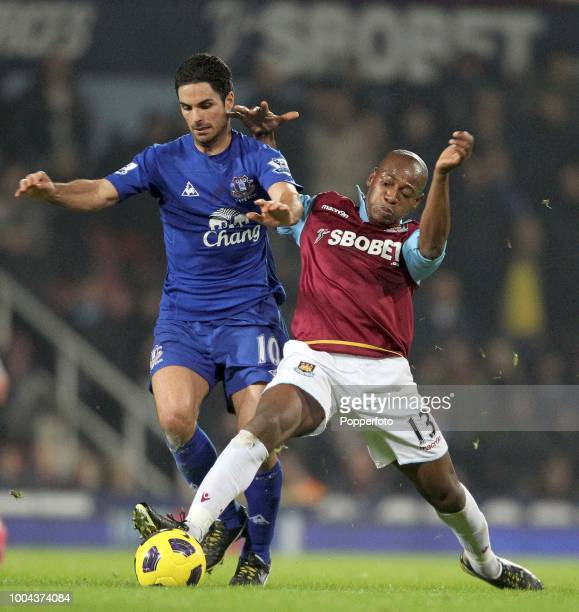 Luis Boa Morte of West Ham United battles with Mikel Arteta of Everton during a Barclays Premier League match at Upton Park on December 28, 2010 in...