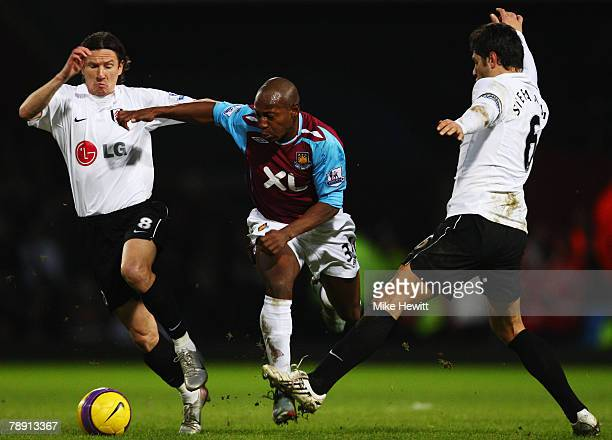 Luis Boa Morte of West Ham United is challenged by Alexey Smertin and Dejan Stefanovic of Fulham during the Barclays Premier League match between...