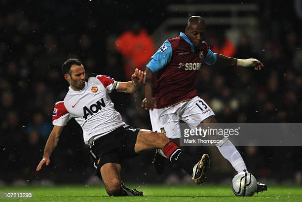 Luis Boa Morte of West Ham United is challenged by Ryan Giggs of Manchester United during the Carling Cup Quarter Final match between West Ham United...