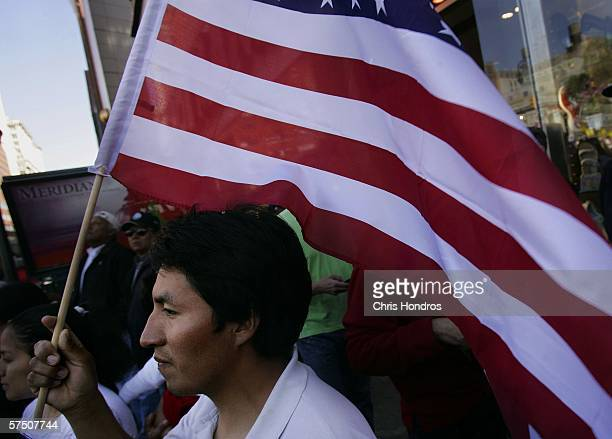 Luis Bordiega orginally from Ecuador holds a American flag during a rally of thousands against proposed crackdowns on illegal immigrants in Union...